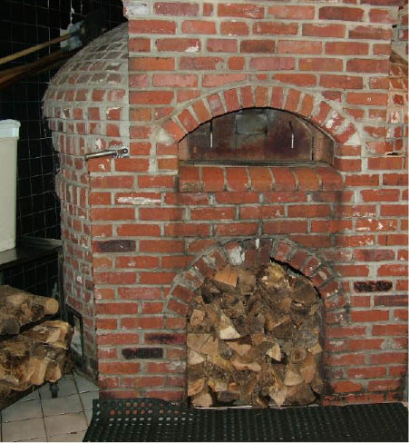 brick fireplace at Carlucci's Italian Grill in W. Windsor; pasta; appetizers; shrimp; wine