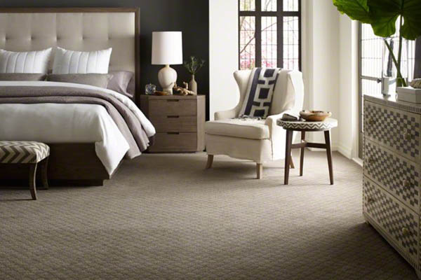 Neutral carpet in neutral bedroom; home decorating; flooring in Pewaukee; Carpetland.