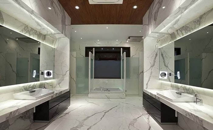 Italian marble floors, wall tiles and counter tops make a dramatic bathroom statement