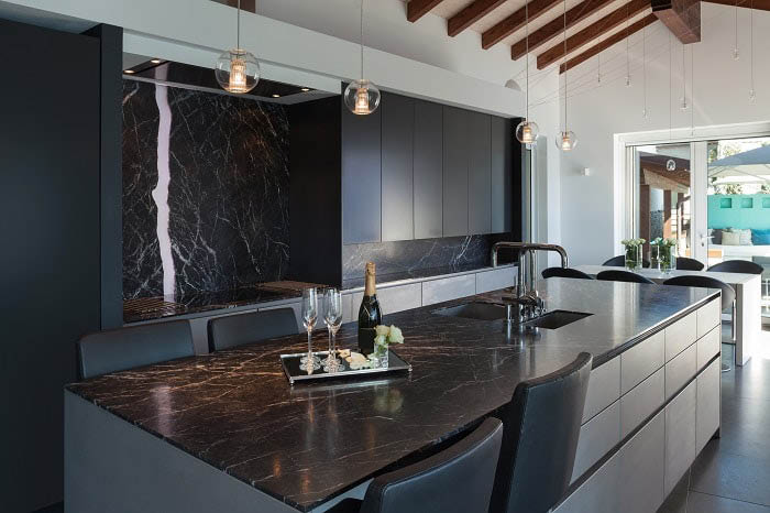 Marble counter top and back splash accents in your kitchen
