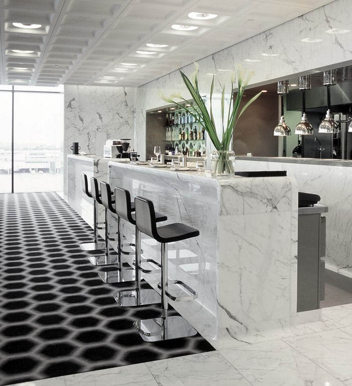 Distinctively modern bar area in beautiful white Carrara Italian marble