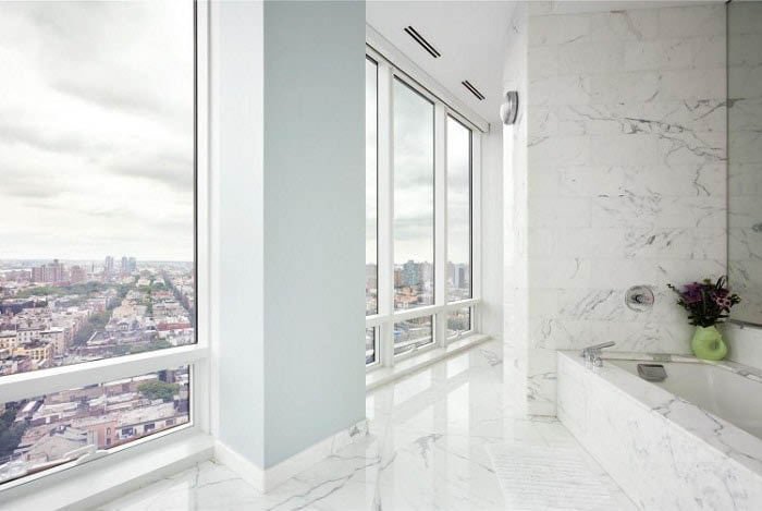 Elegant marble wall tiling, tub surroundings and flooring from Carrara Italian Marble Import