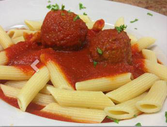 Penne pasta dinner with meatball and sauce