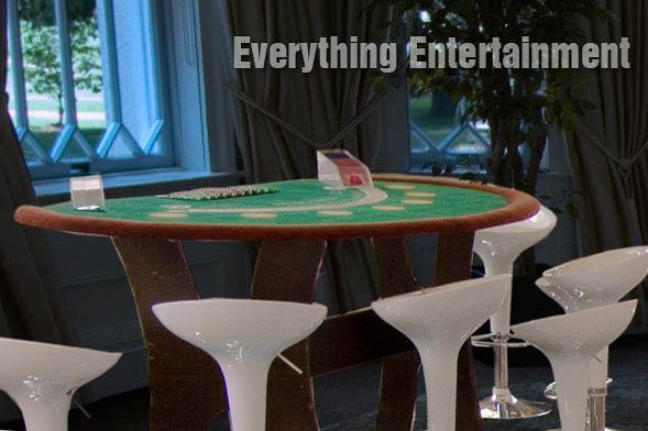 Casino, party casino, casino table rental, black jack, craps table, poker table rental, raffle drum rental, slot machine rental, video horse racing, black jack table rental, tent rental, event planning, event planning discount