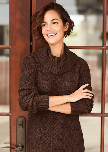 smiling woman in a Christopher and Banks cowl neck sweater