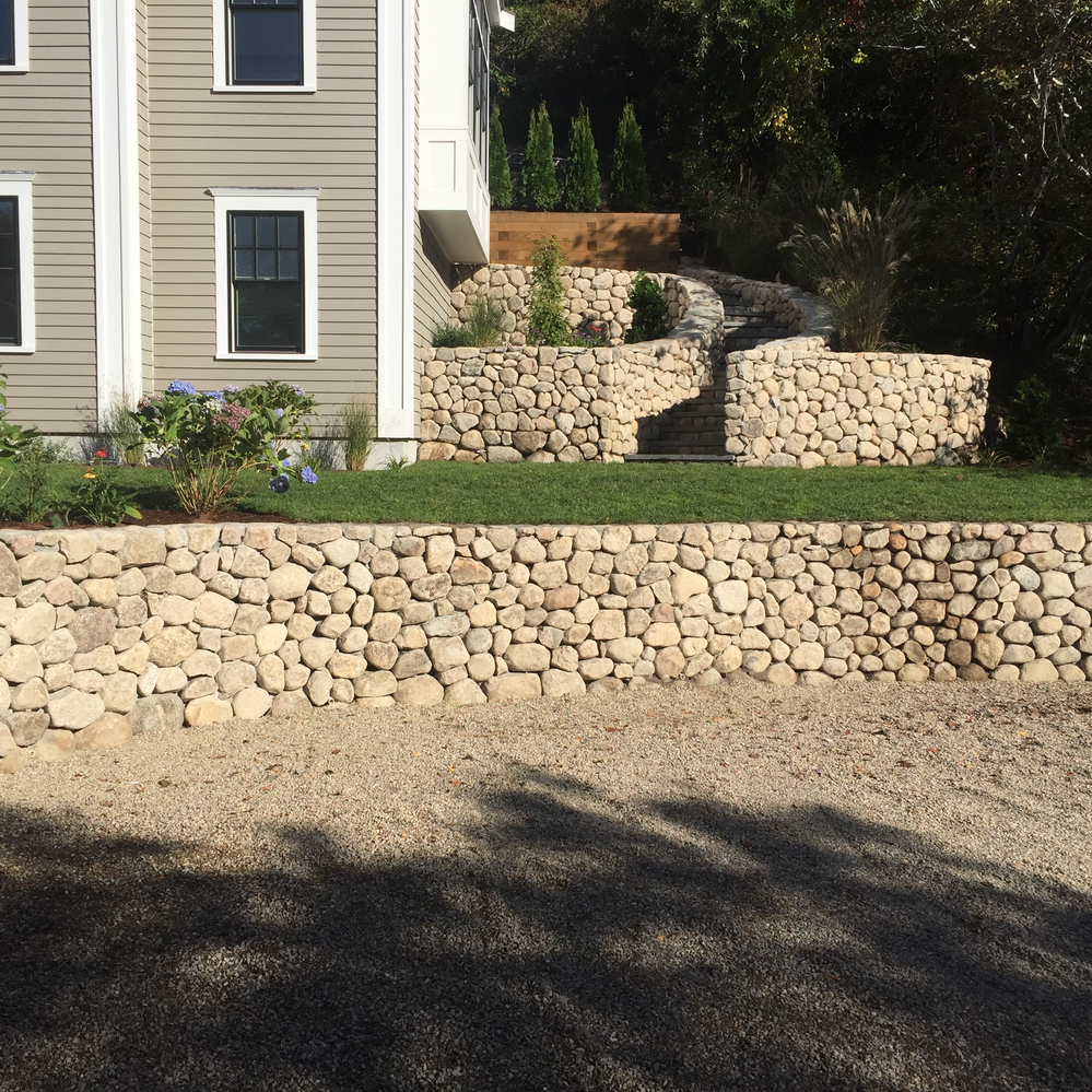 A retaining wall allows you to have multiple flat tiers in the yard. It also allows for the separation of activities. Looking for ideas or need some help pricing. Call today for a FREE consultation & estimate.