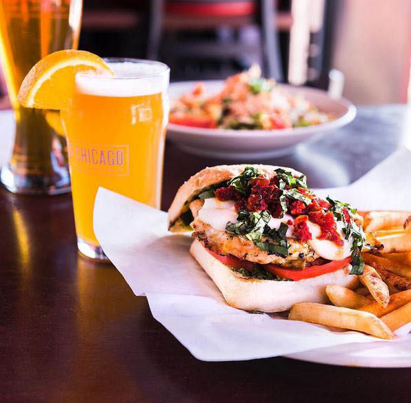 Delicious overstuffed hot sandwich, cold craft beer and fries