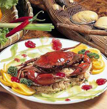 Seafood crab on a bed of rice and vegetables gourmet Chinese