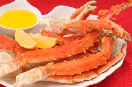Snow crab legs dipped in lemon and butter