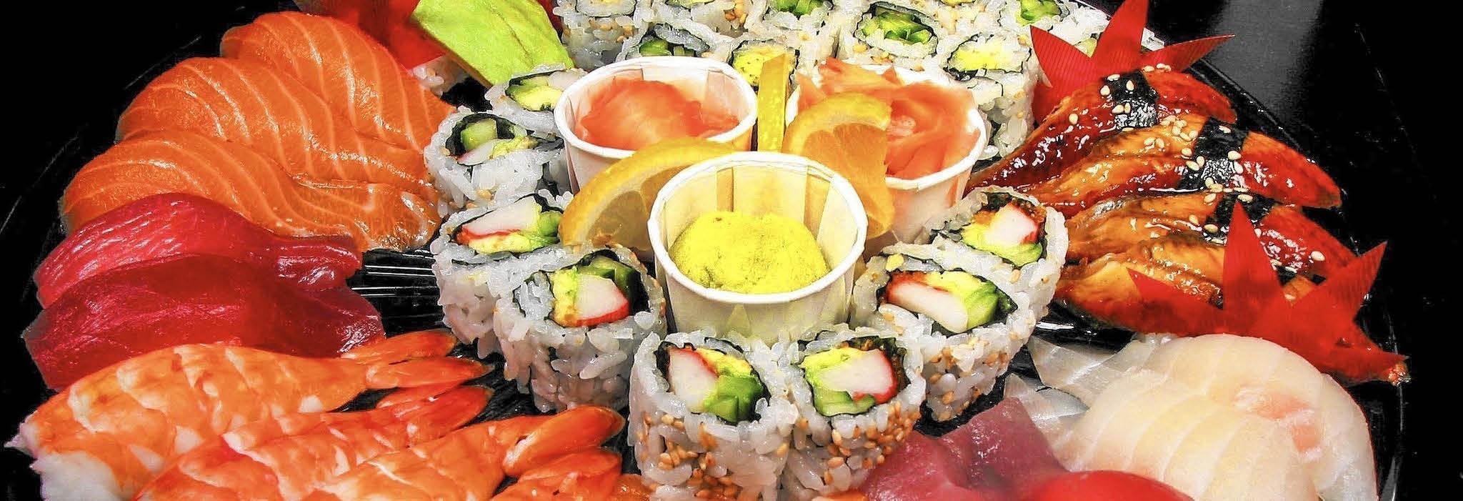 Platter-presentation of sushi and sashimi variety