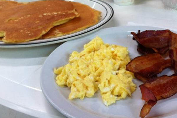 Photo of Chuck's Place Restaurant near Cedarburg, WI huge breakfast pancake and eggs.