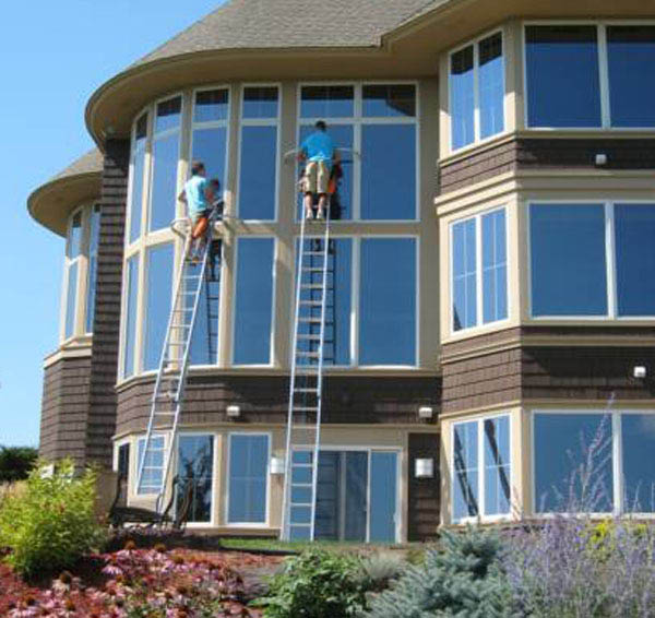 Window washing on a three story house by Burrini in New Jersey