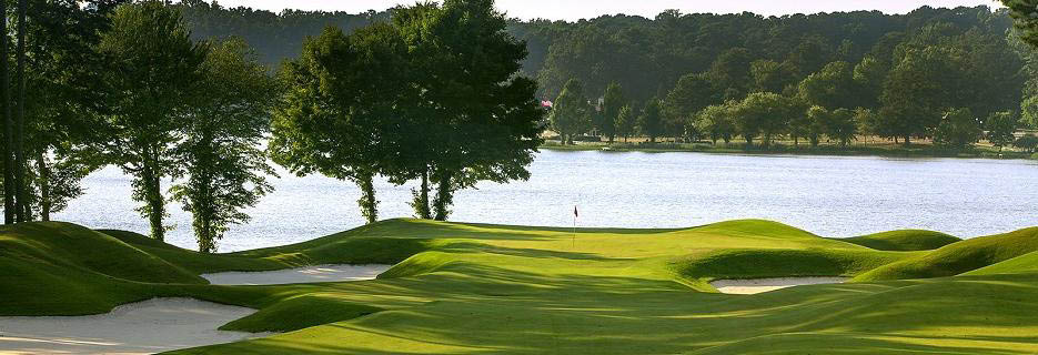 Golf course next to Lake Acworth showing a hole and surrounding sand traps