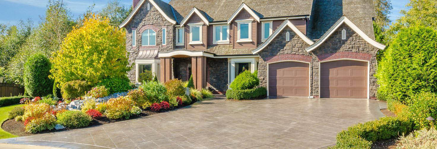 Stamped concrete driveway for a textured look finish