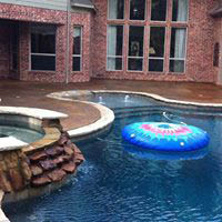 Pool deck featuring stamped concrete