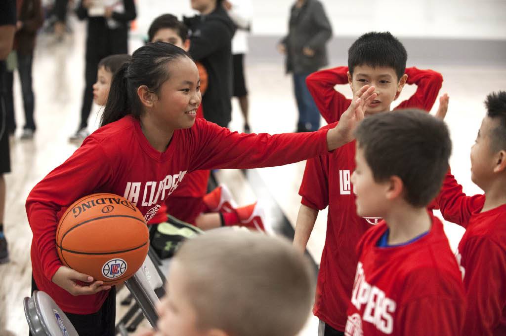 Youth Basketball teams high fiving success
