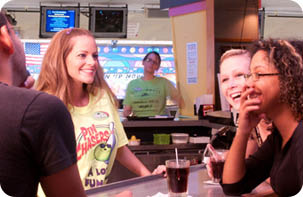 Bowling Coupons Bowling coupons near me Tampa Adults having fun bowling at our Pin Chasers Tampa location