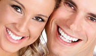 Happy patients showing off their whitening job.