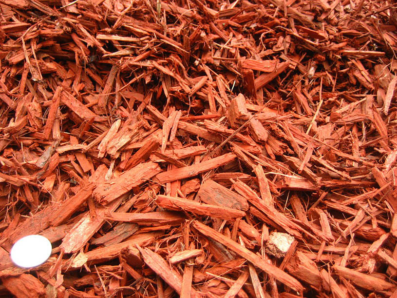 Red mulch and grounded bark for landscaping
