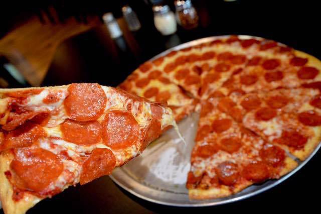 slice of thin crust pepperoni