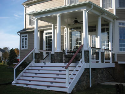 White stairs with beautiful stonework siding