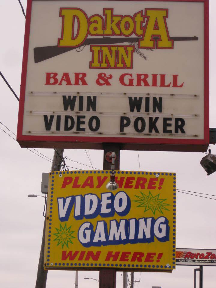 Outdoor sign at Dakota Inn Bar & Grill.