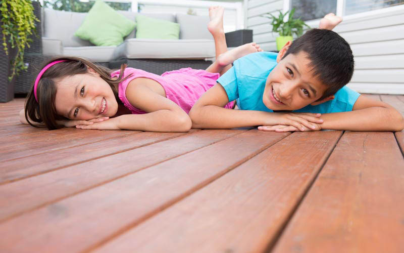 kids lying on deck
