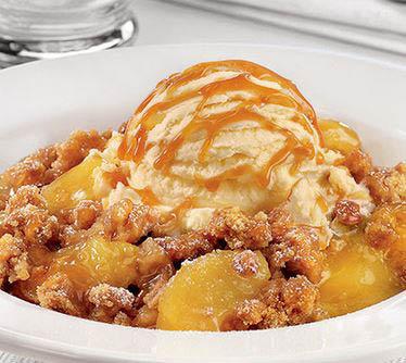 Warm apple crisp covered with vanilla ice cream and caramel sauce!