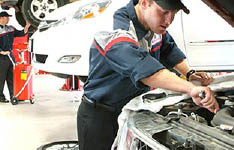 Brakes Plus ASE certified technician working on a vehicle