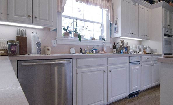 White cabinetry with stainless steel dishwasher