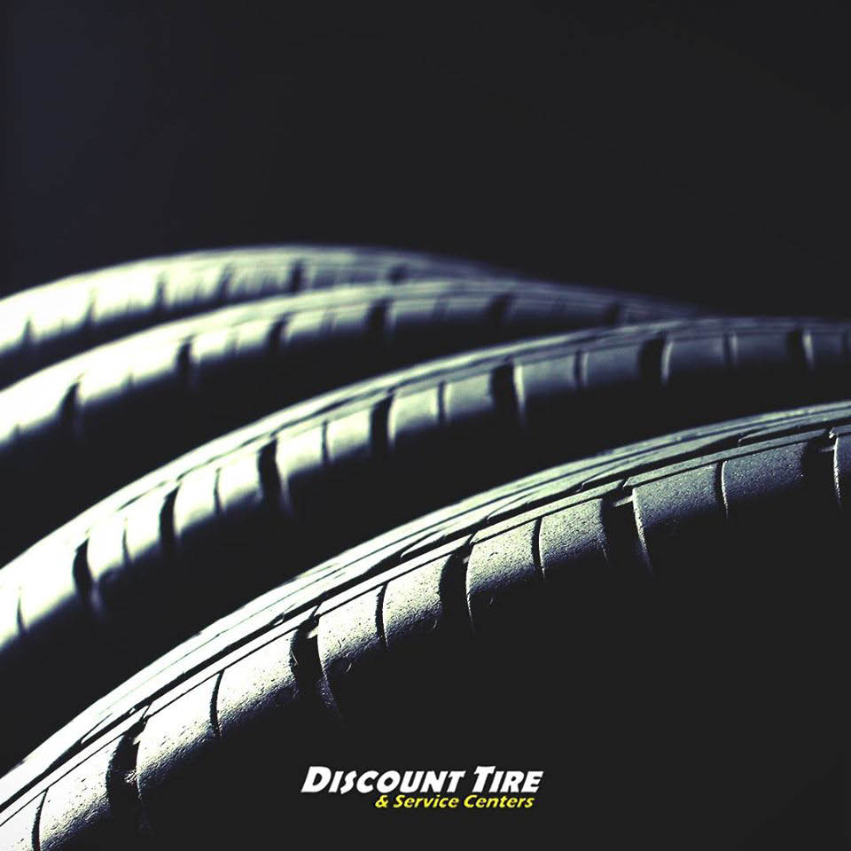 stacks of auto tires outside Discount Tire Centers in Lake Forest, CA; tire sale; discount tires