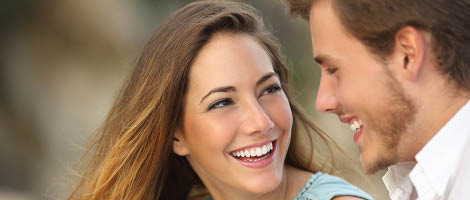 Woman and man smiling - 1-hour teeth whitening
