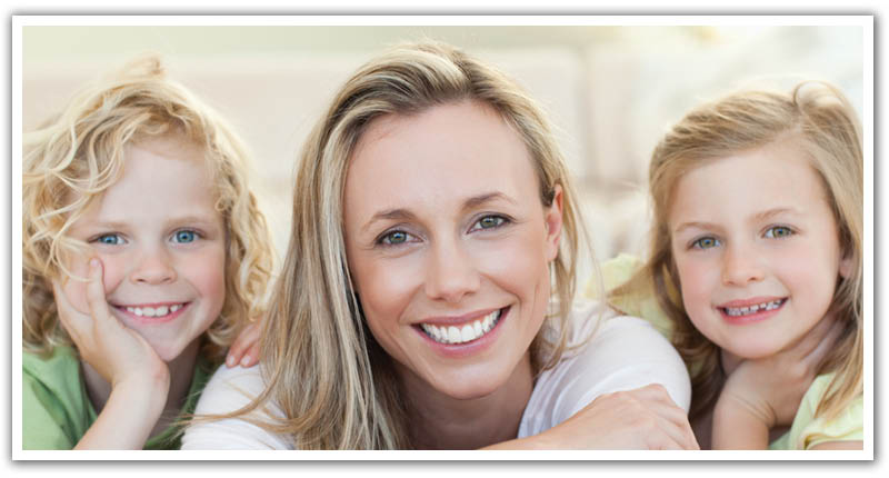 Mom with kids smiling with white and great teeth