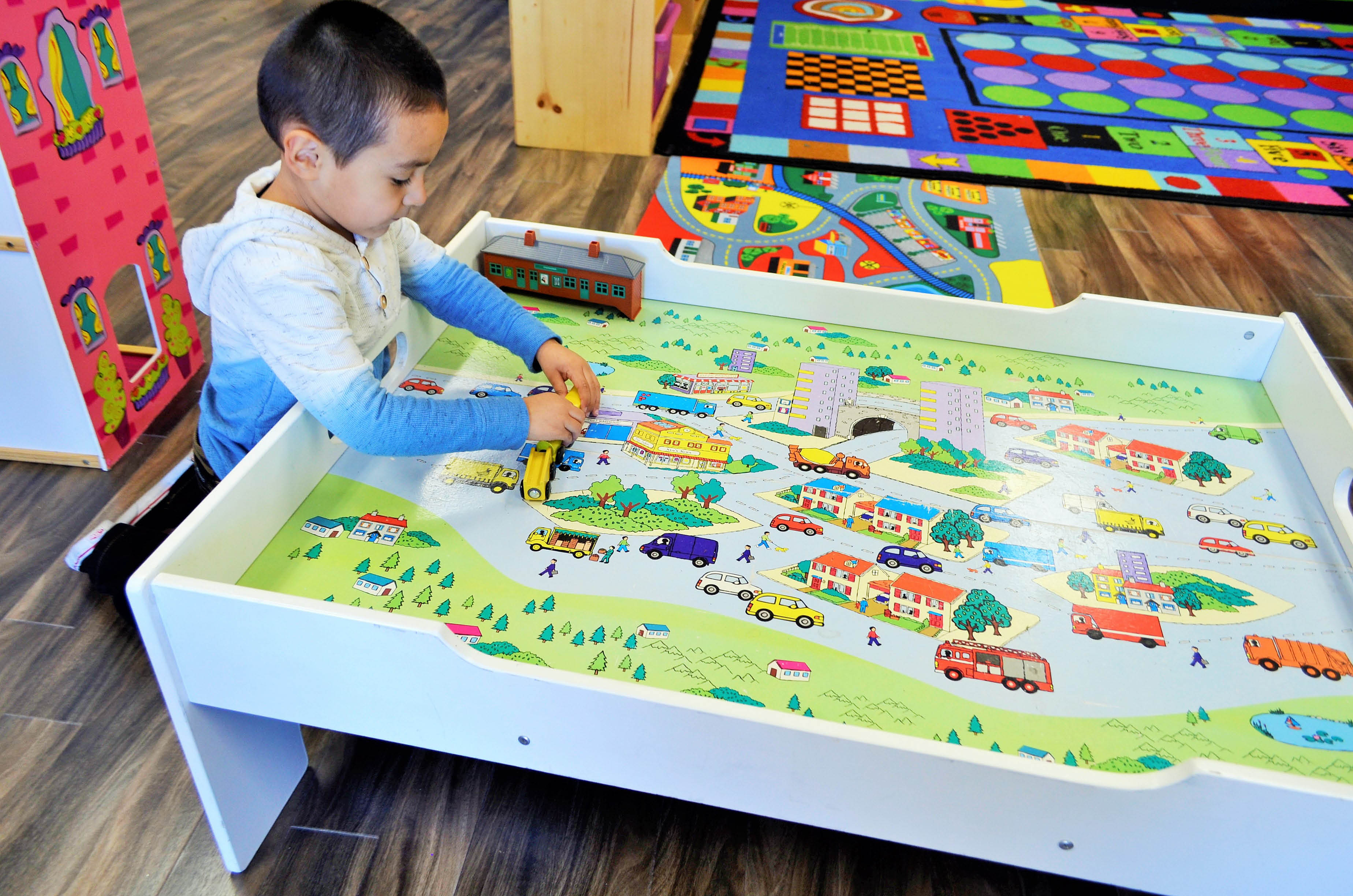Child playing on train table