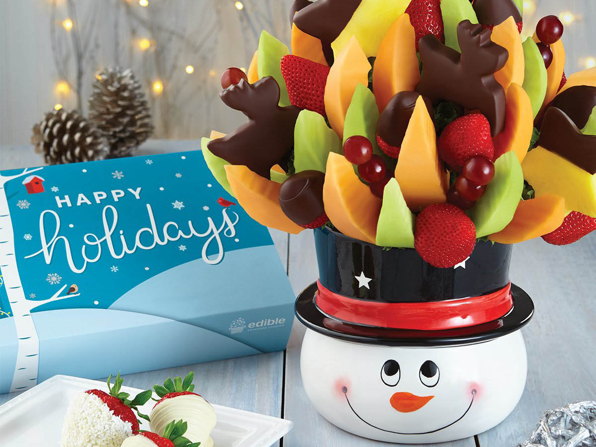 Edible Arrangements mixed fruits, chocolate dipped fruits plus chocolate reindeer and stars
