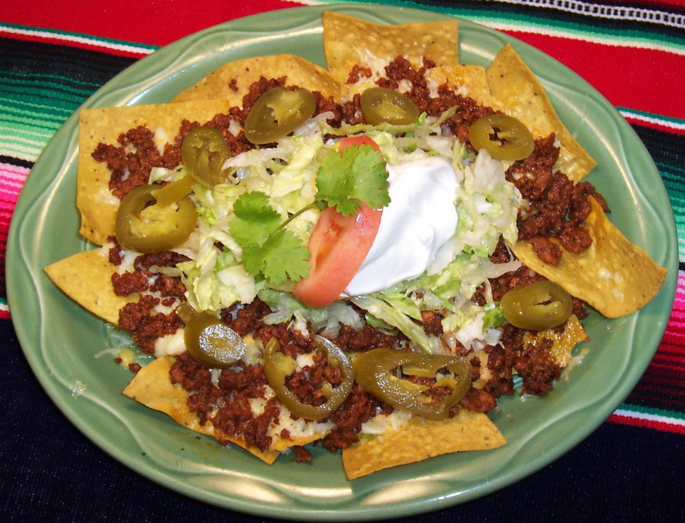 Chow down on nachos with grilled beef.