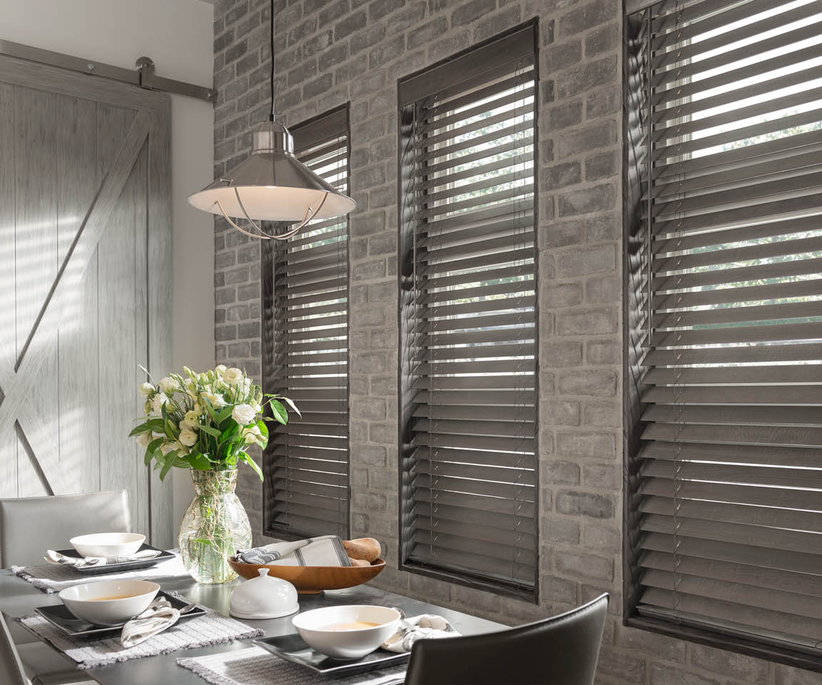 Faux wood blinds offer the classic appeal of real wood blinds, with even greater added benefits!