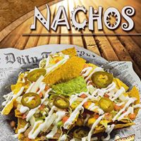 Nachos piled high with Mexican toppers