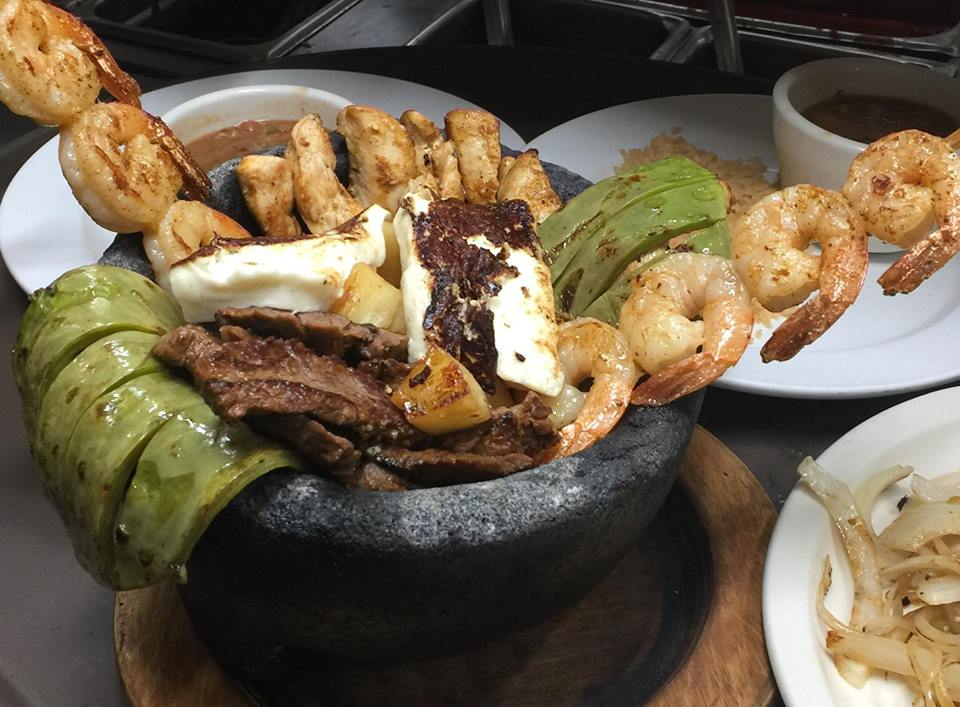 Traditional Mexican Molcajete with grilled fajita skirt steak, shrimp and queso. Authentic Mexican recipes; El Porton Georgia