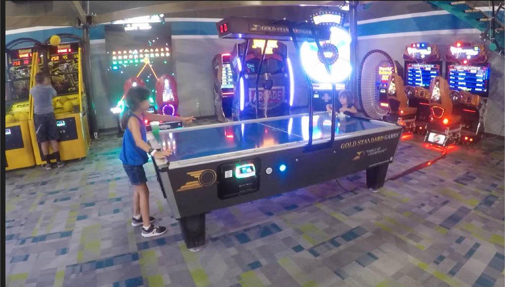 kids playing arcade games at Epic Fun