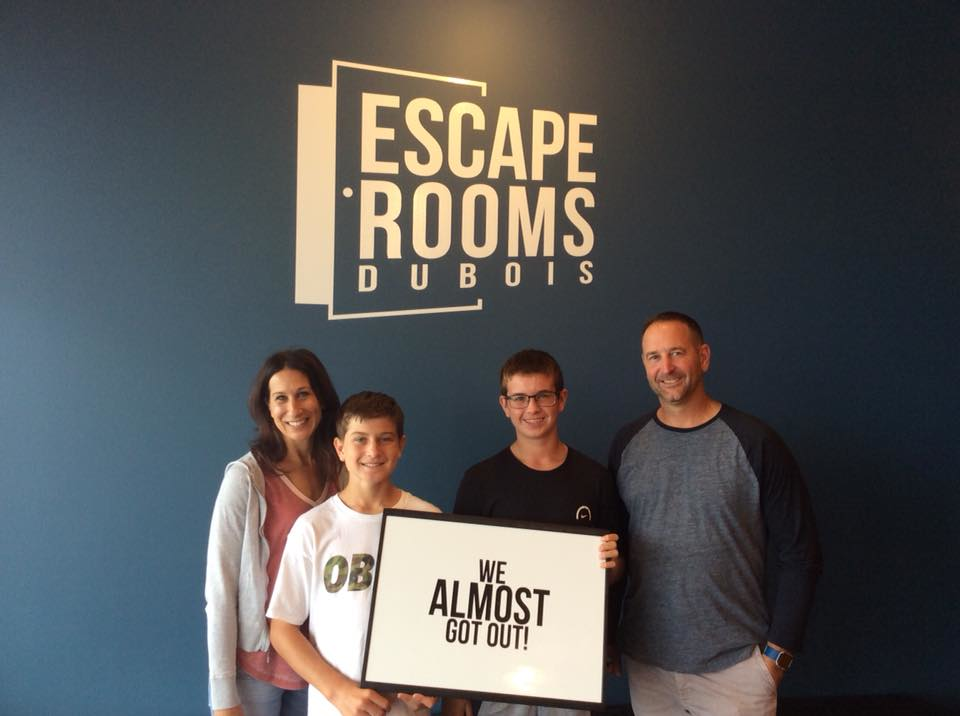 family after completing the escape room challenge in DuBois, PA