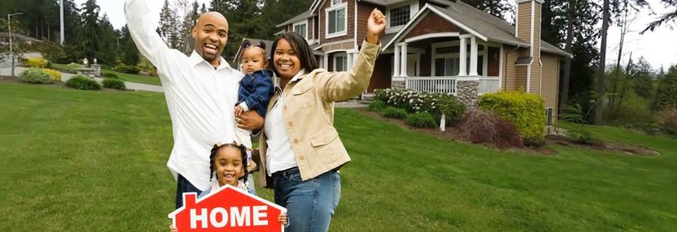 Family celebrating they bought a new home with Senter LEgal Services.