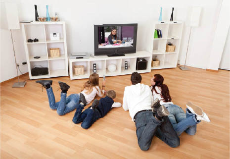 Family watching television in the basement. Healthy, dry basement; family spaces Everdry South Bend