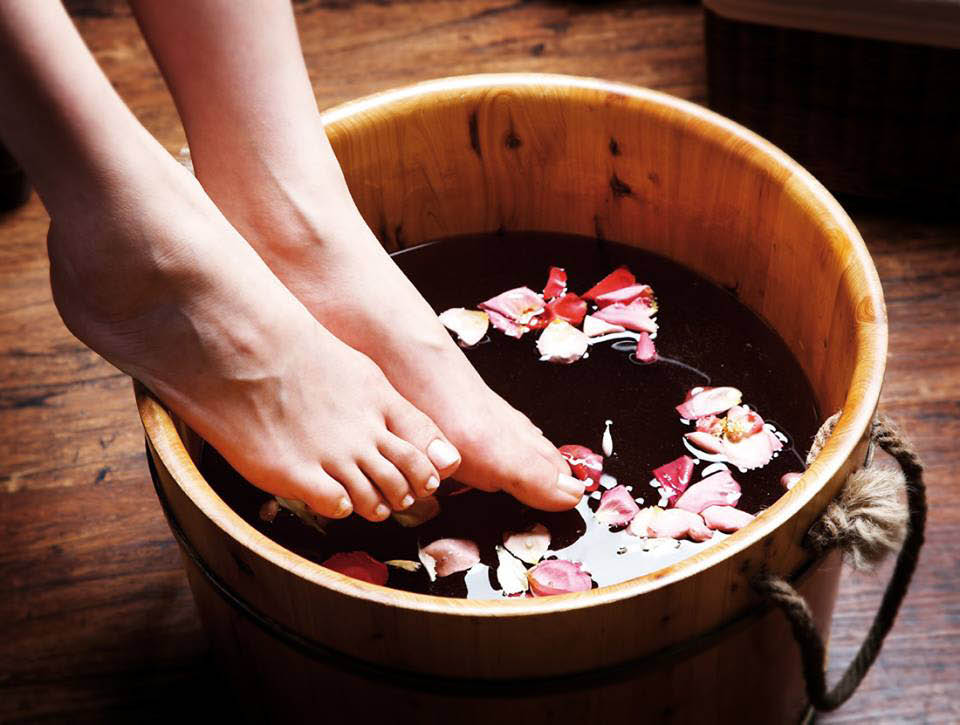 Hot foot bath with flower petals for relaxing
