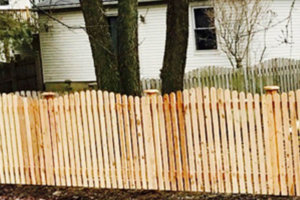 Fenced In wood fence installation
