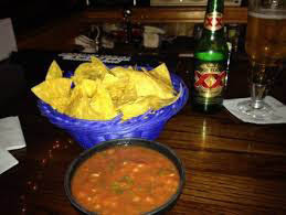 Homemade chips and salsa with a cerveza or two