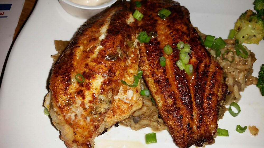 Hand-breaded fried catfish over rice