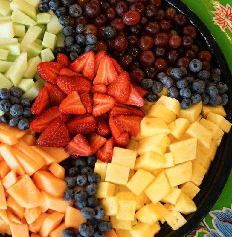 Catering services available like a fruit and cheese party tray