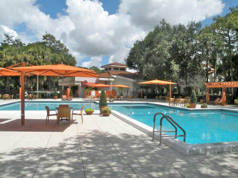 swimming pool and patio area at Forest Trace Independent Assisted Living in Florida