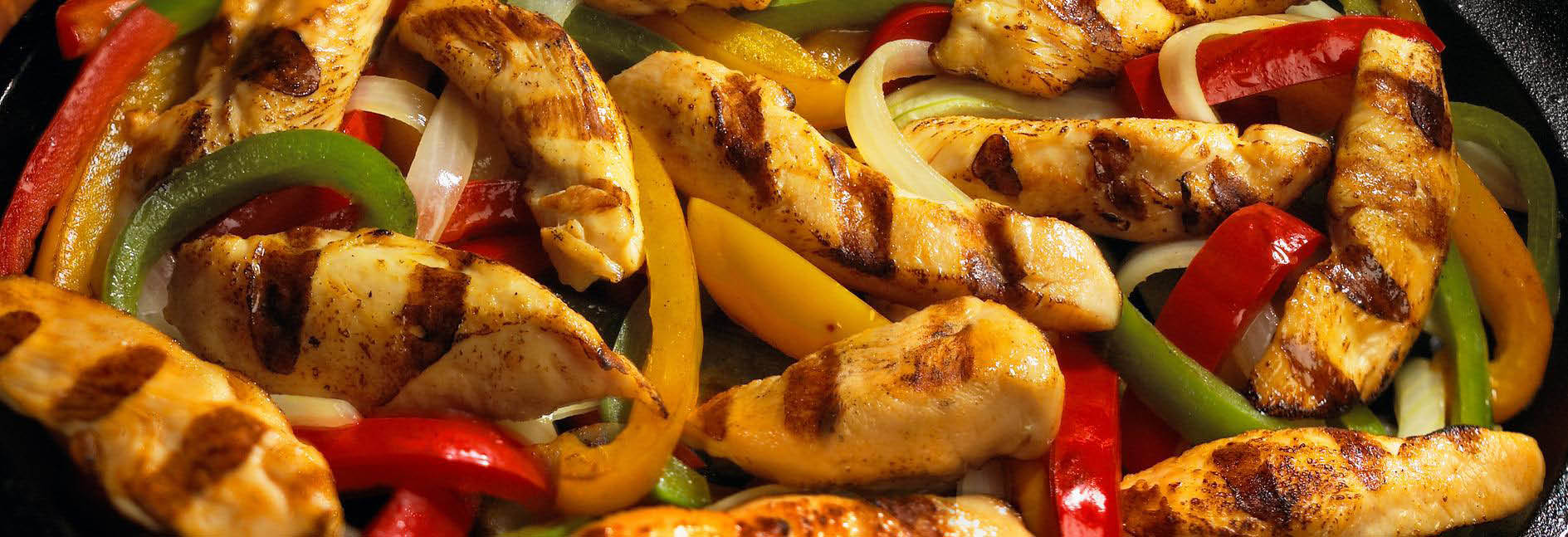 Fresh chicken strips with peppers and onions banner